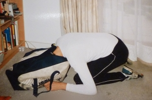 Hubby with his head zipped into sports bag, in exasperation
